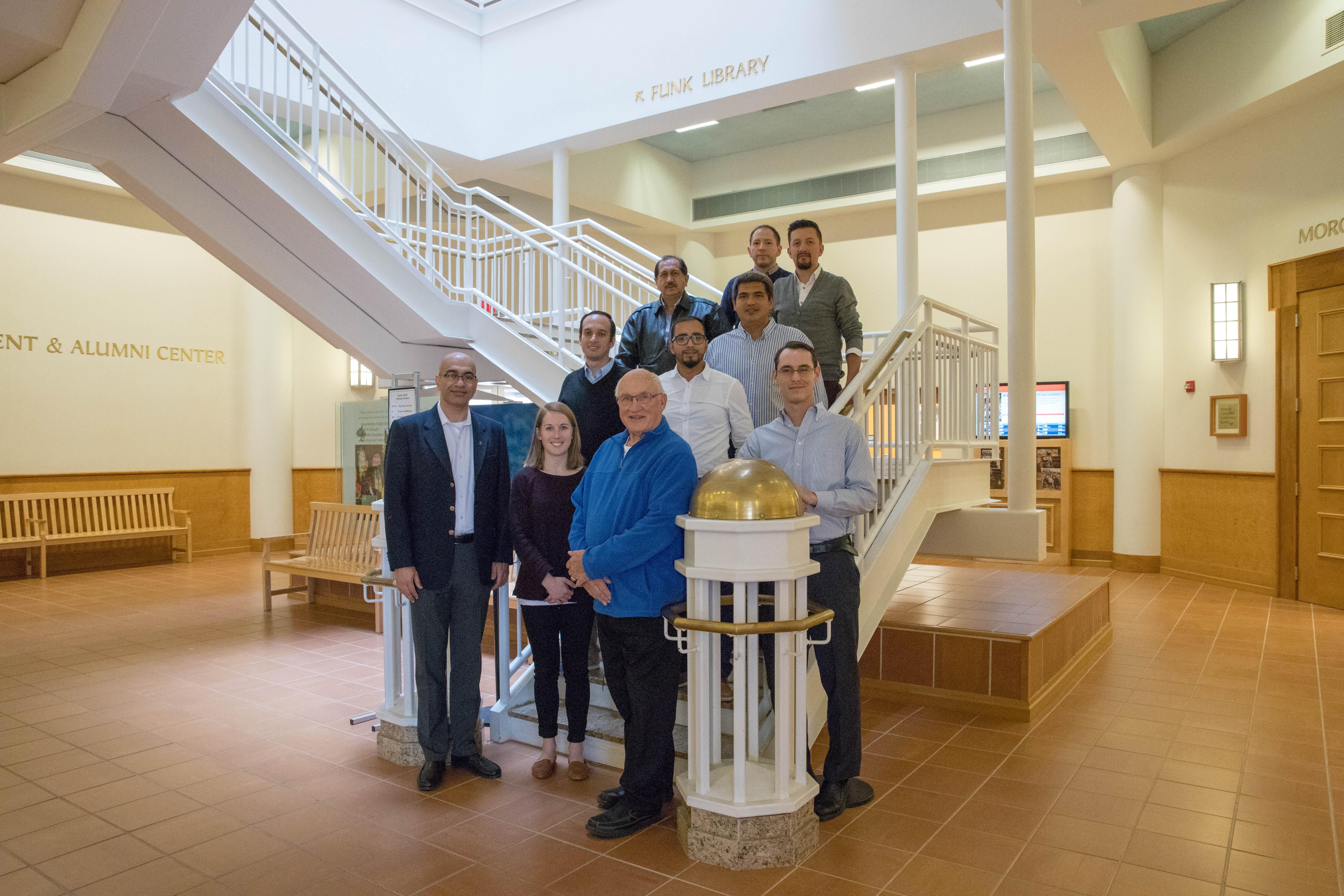Group shot of five Cochran Fellows and UIUC representatives